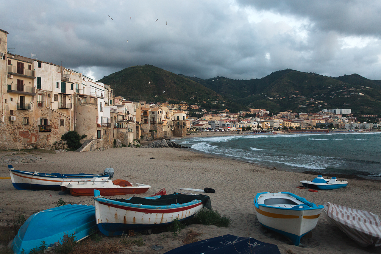 cefalù boats on the beach